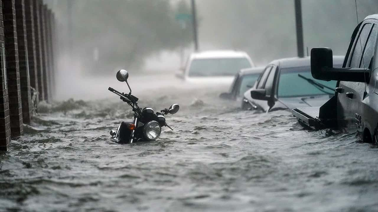 Photo of cars in flood waters